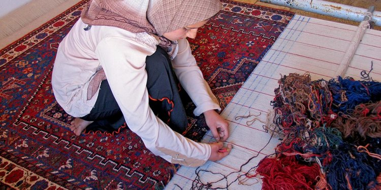 Kneeling and hand weaving