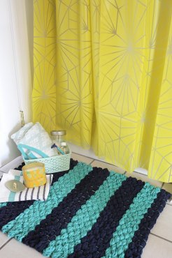 make your very own woven bath mat with finger-knit fabric yarn using this easy tutorial over at title=